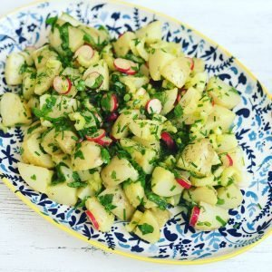 platter of homemade potato and radish salad with herby olive oil dressing