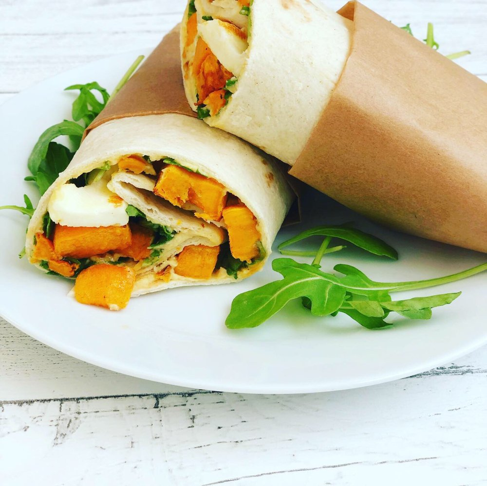 vegetarian wrap with sweet potatoes, halloumi, hummus and salad.
