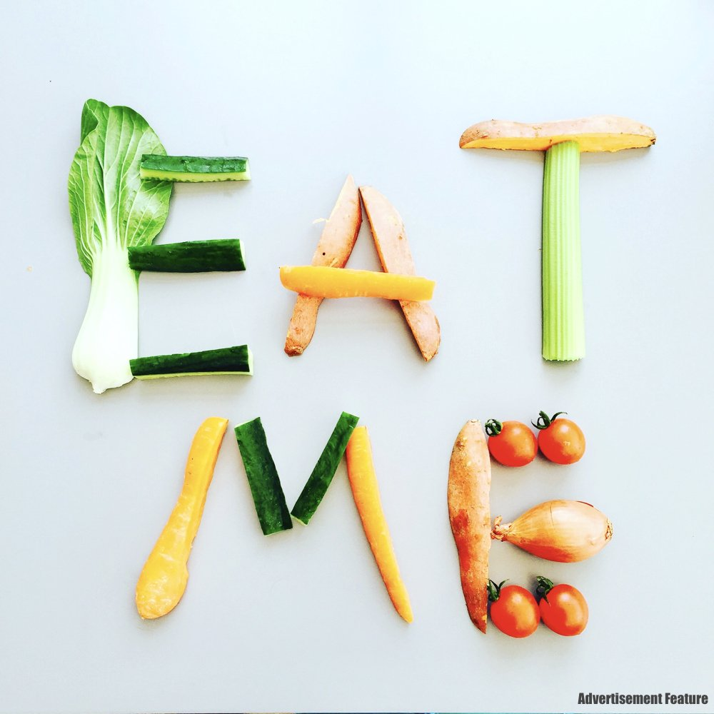The words Eat Me made from vegetables