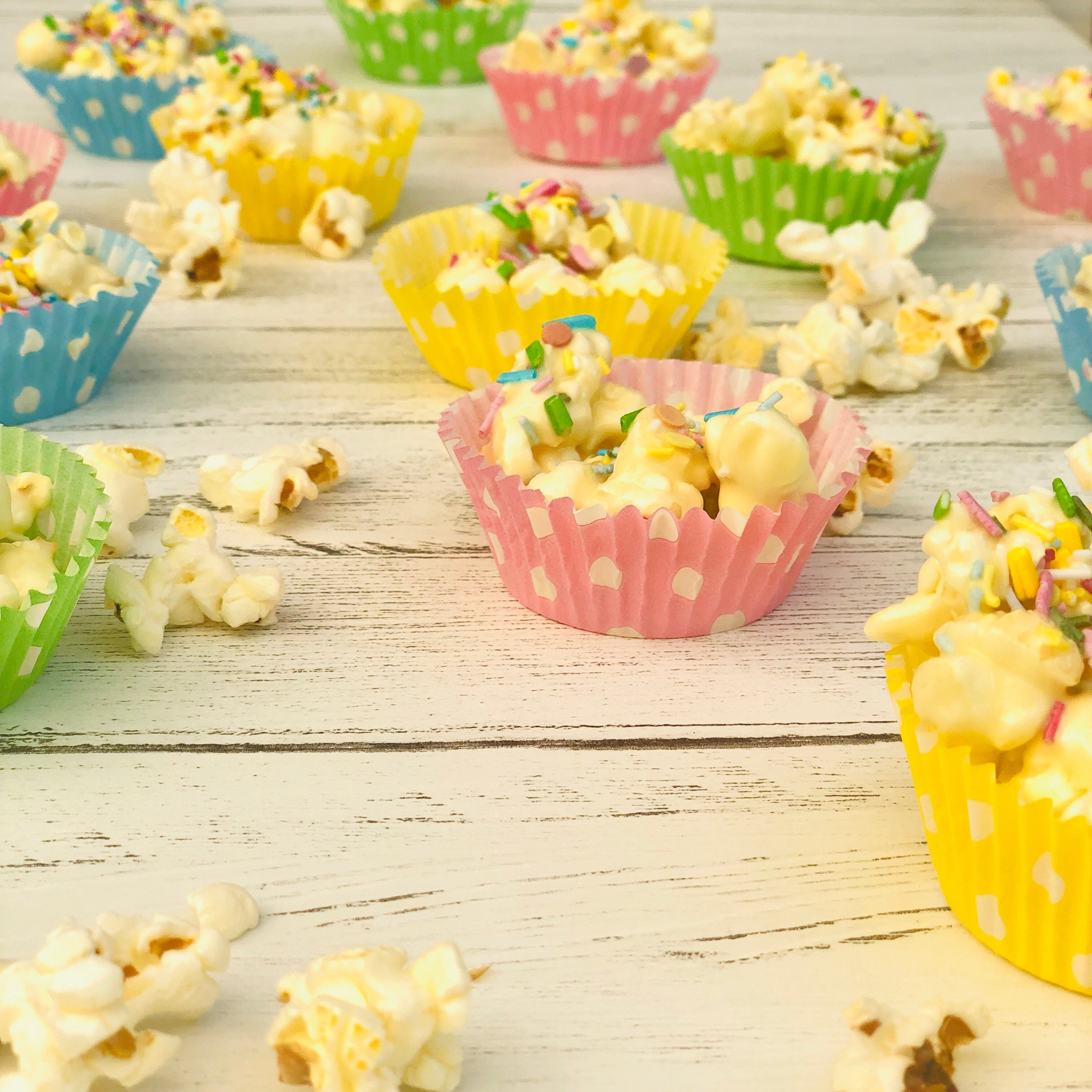 homemade popcorn cakes in pastel coloured spotty paper cases.