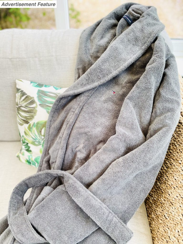 Father's Day gift ideas - Tommy Hilfiger bath robe from Mainline thrown onto the arm of a wicker sofa