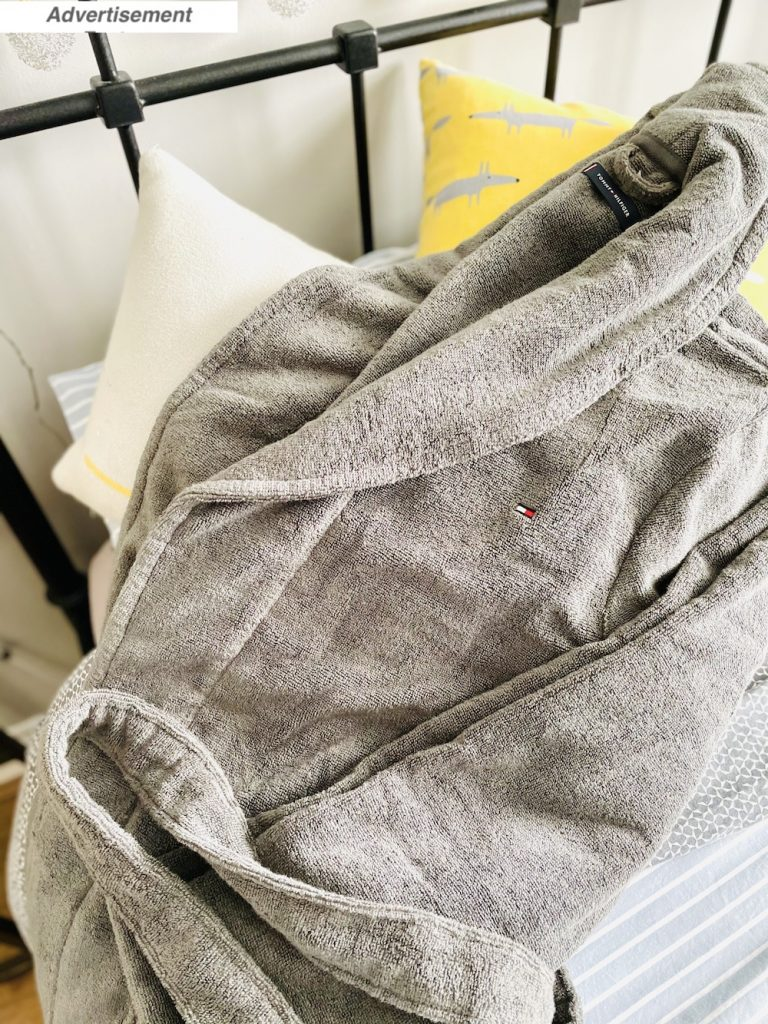 Fathers Day Gift Idea - Tommy Hilfiger bath robe from Mainline thrown onto the pillows on the bed