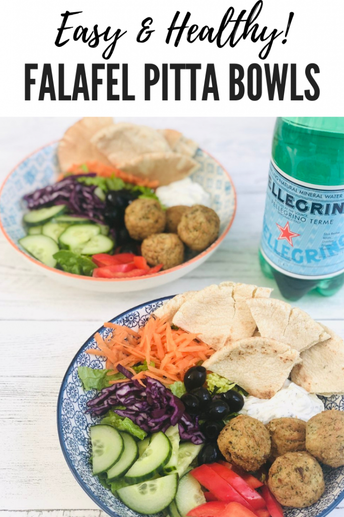 """falafel pitta lunch bowl with falafel, pitta bread, carrots, cabbage, lettuce, cucumber, red peppers and minty yogurt dip. Text overlay reads """"easy and healthy falafel pitta bowls"""""""