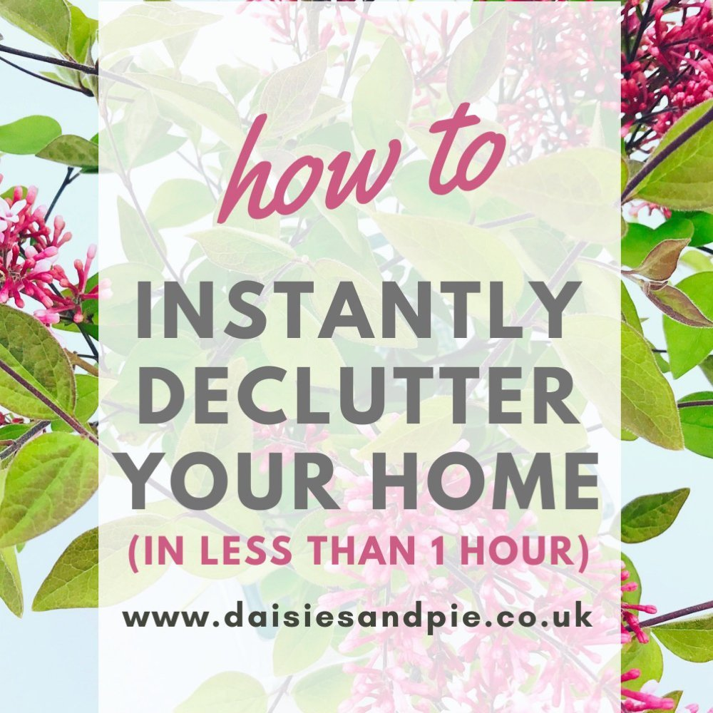 "vase of lilacs. Text overlay ""how to instantly declutter your home in less than 1 hour - www.daisiesandpie.co.uk"""