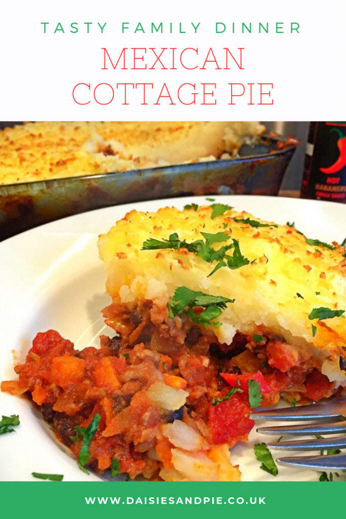 Mexican Cottage Pie served alongside hot chilli sauce