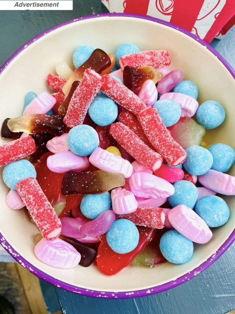 Pick & Mix London sweets tipped into a metal serving bowl