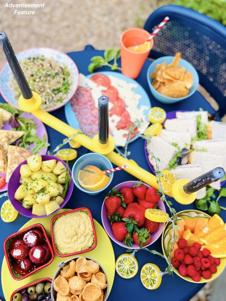 picnic food ideas - boiled new potatoes, stuffed peppers, hummus and crisps, strawberries, melon and raspberries, rice salad, cheese and neat platter, sandwich platter