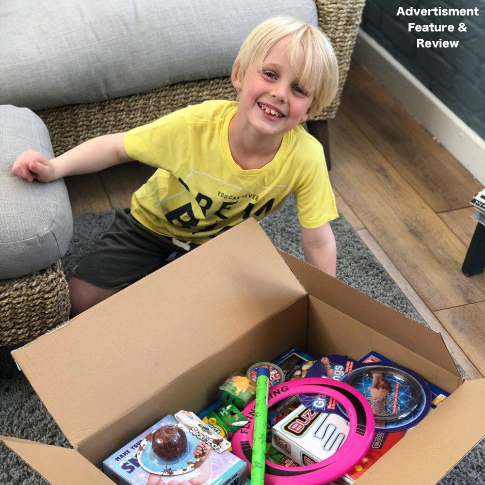 boy opening box of toys from poundtoy website