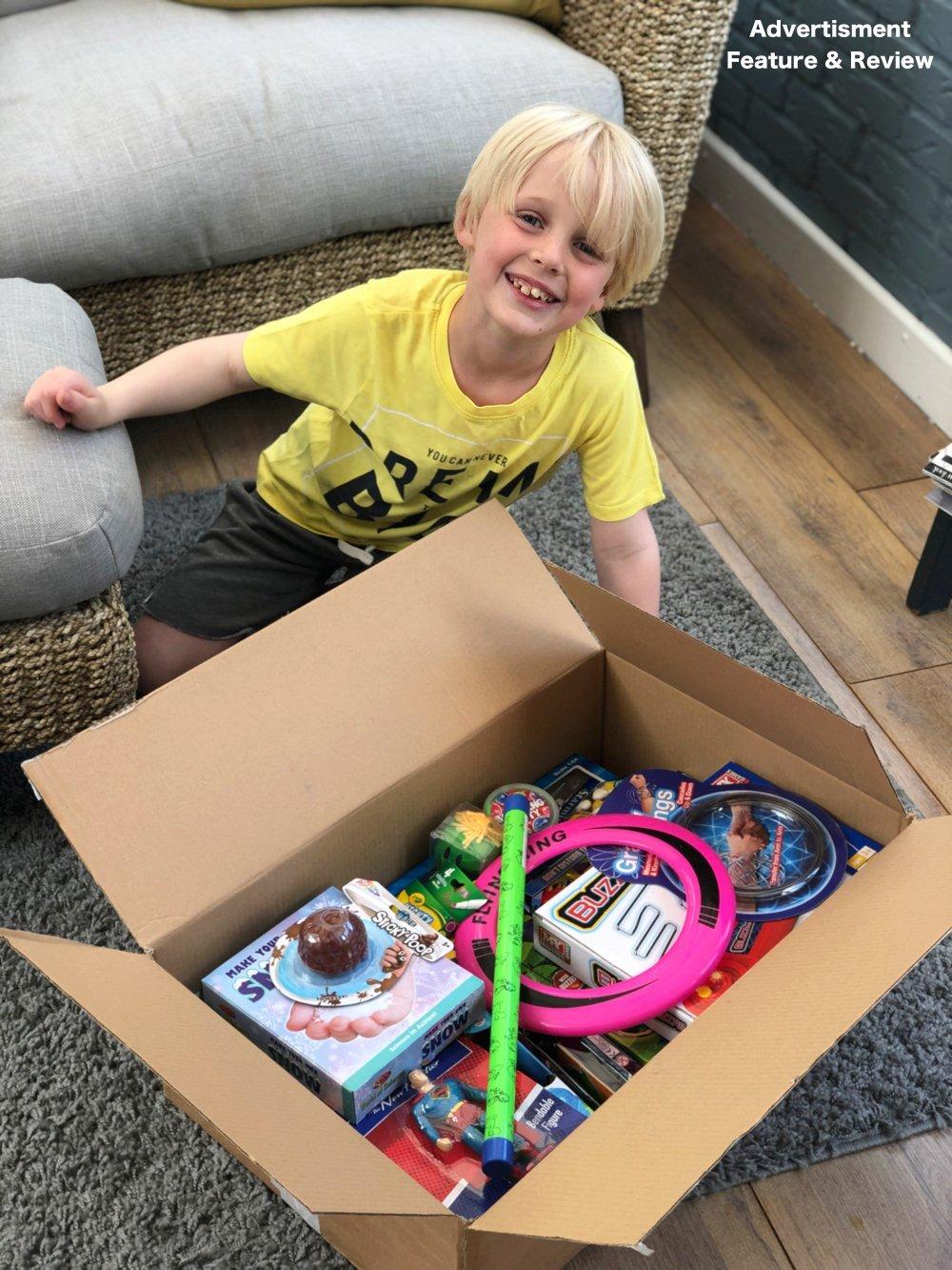 boy opening box of toys from poundtoy