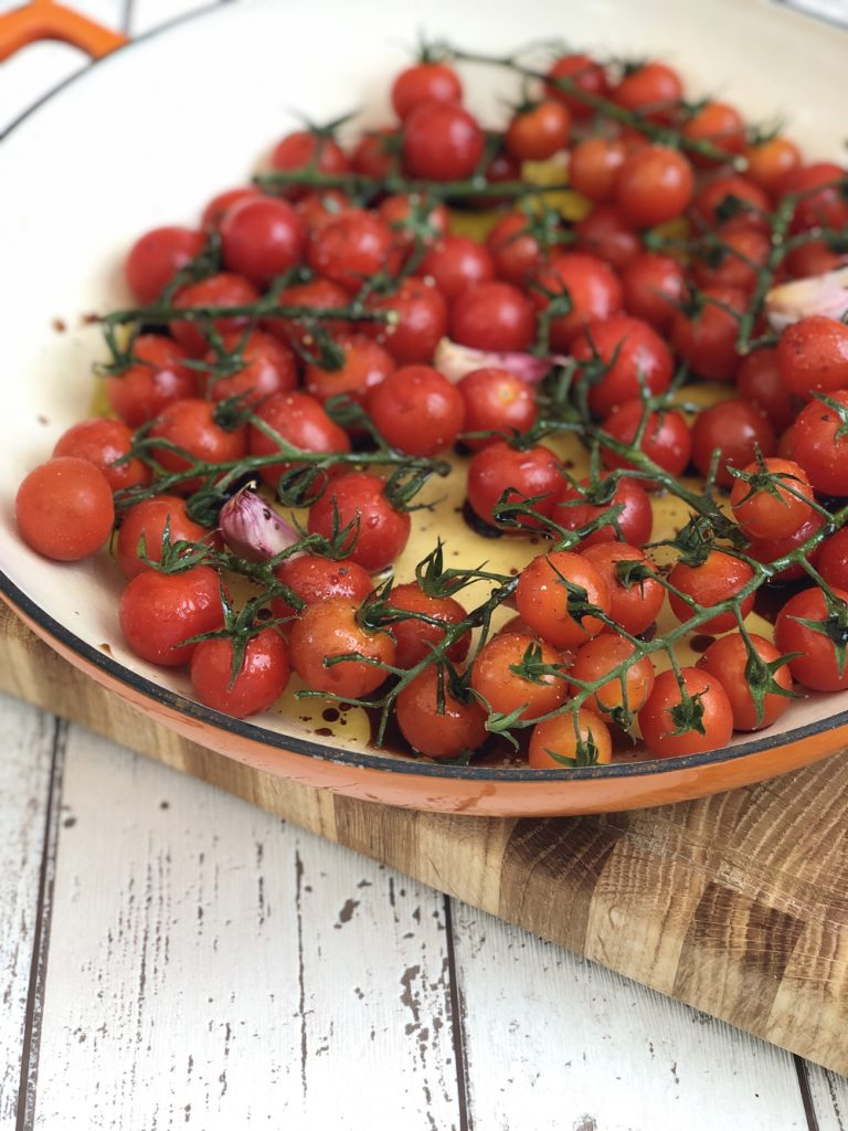 enamel pan filled with vine tomatoes ready to make roasted cherry tomato pasta sauce