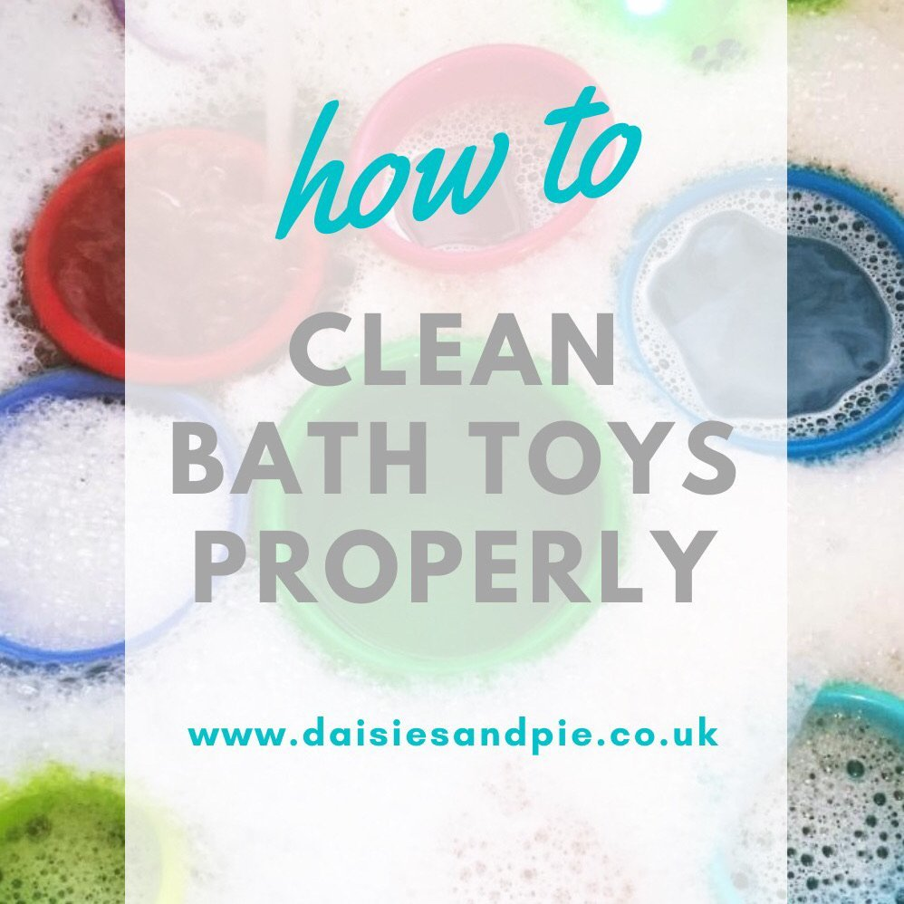 "sink full of kids bath toys soaking in hot soapy water. Text overlay ""how to clean bath toys properly"""