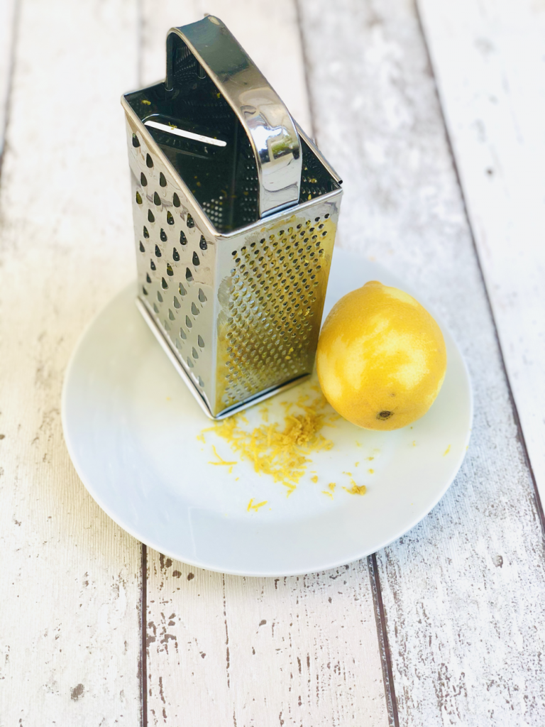 lemons being grated to get the zest
