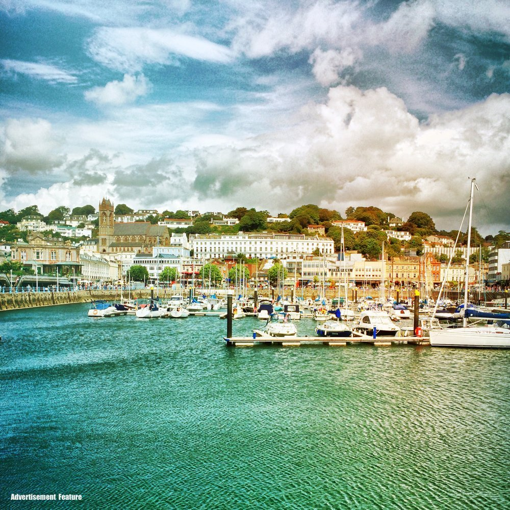 view across Torquay Harbour with the town in the background