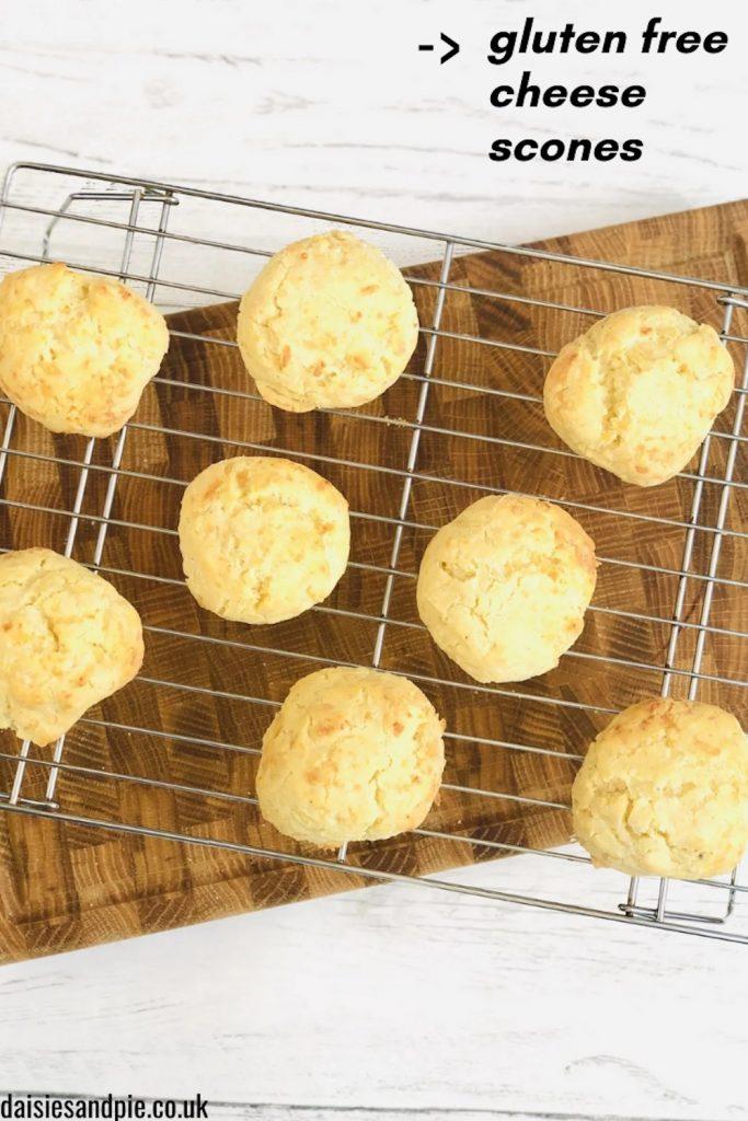"tray full of freshly baked gluten free cheese scones. Text overlay reads ""gluten free cheese scones"""