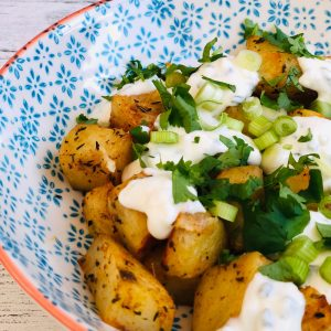 homemade herby diced potatoes with soured cream, spring onions and freshly chopped herbs - what to serve with fajitas
