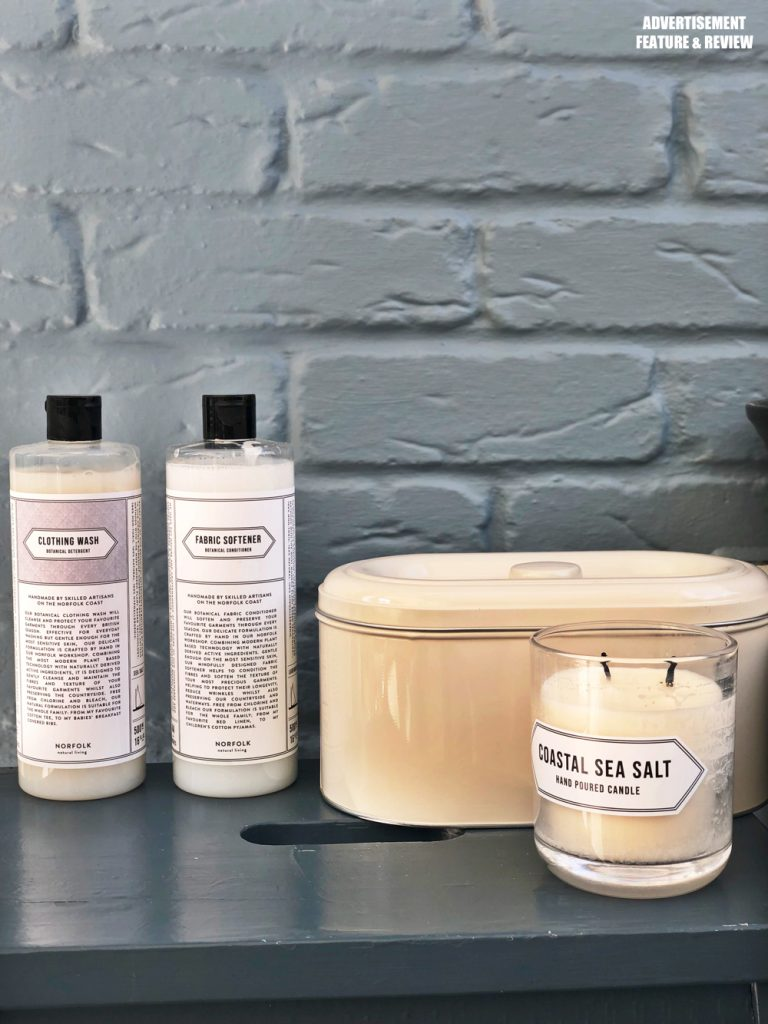 eco friendly laundry detergent and fabric softener from Norfolk Natural Living alongside a coastal sea salt scented candle