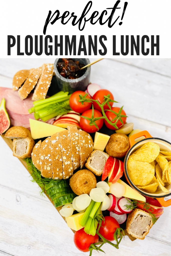 "ploughman's lunch platter with bread, cheese, pork pies, chutney, fruit and salad. Text overlay ""perfect ploughman's lunch"""