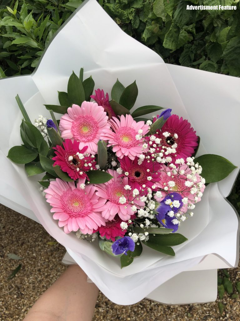 Kate's Bouquet charity flowers for Cancer Research - bouquet contains pink germinis, blue iris, gypsy grass and ruscus