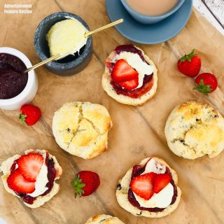 platter of homemade scones with strawberry jam and clotted cream