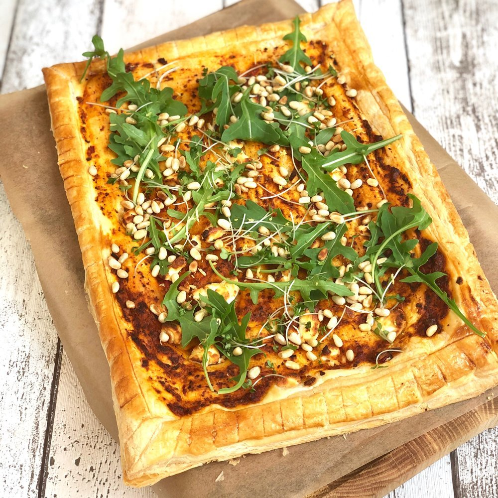 goat cheese tart with rocket and pine nuts.