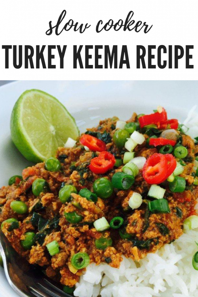 "slow cooker turkey keema curry served with rice and a wedge of lime and sprinkling of red chillies. Text overlay ""slow cooker turkey keema"""