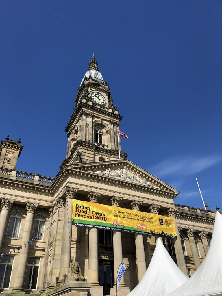 Bolton Food Festival banner strung across the front of Bolton Town Hall