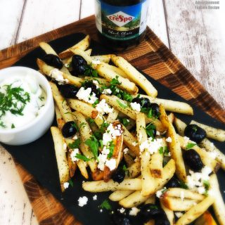 greek style fries - skin on fries with Crespo black olives, crumbled feta cheese and herbs served with a tzatziki dip