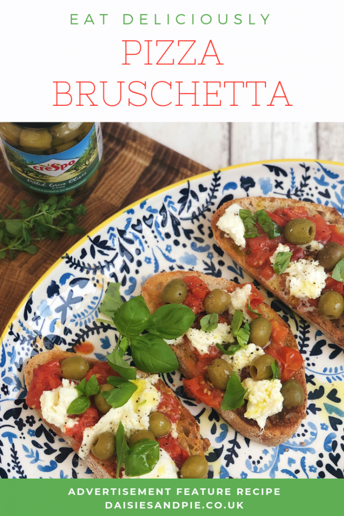 "simple bruschetta topped with roast tomatoes, mozzarella and Crespo green olives. Text overlay ""eat deliciously - pizza bruschetta - www.daisiesandpie.co.uk"""