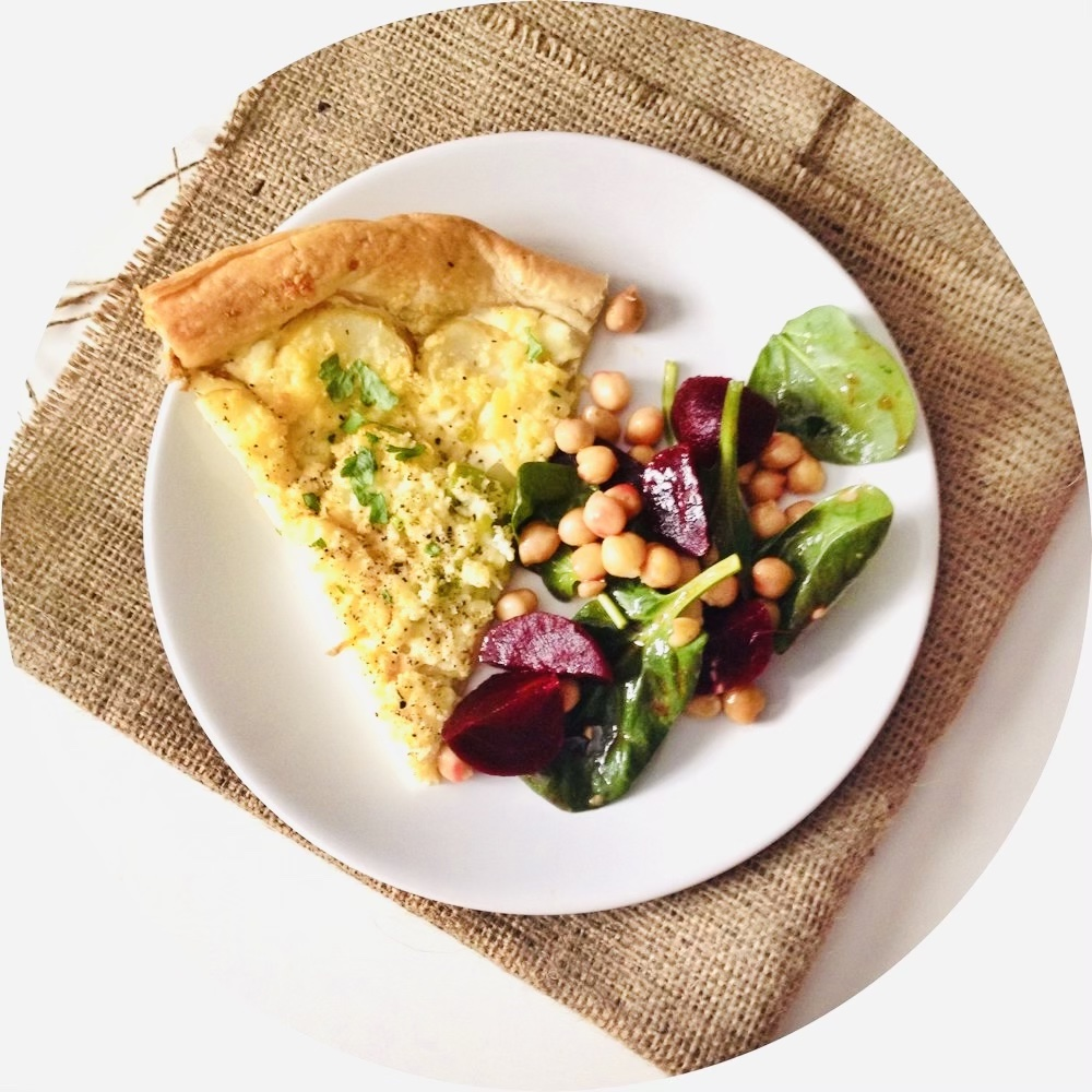 Beetroot Salad with chickpeas and spinach served alongside a slice of cheese and potato tart