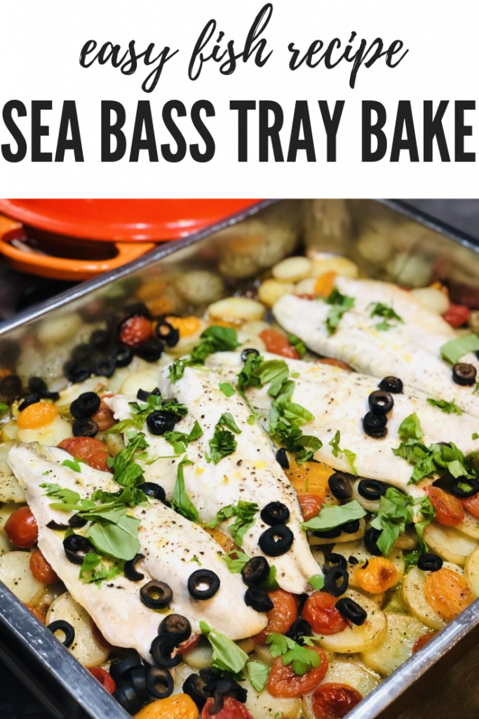 sea bass tray bake with sliced new potatoes, baby plum tomatoes, sea bass fillets, black olives, lemon zest and a scattering of freshly chopped herbs