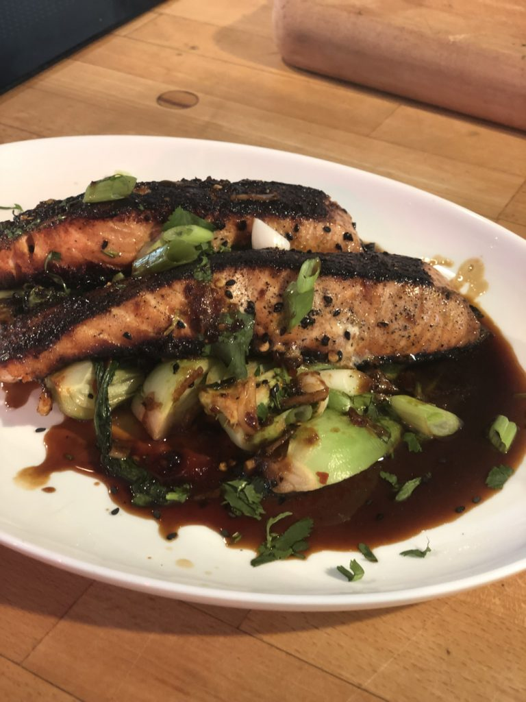 Hairy Bikers soy glazed salmon with garlic bok choi at the Bolton Food Festival