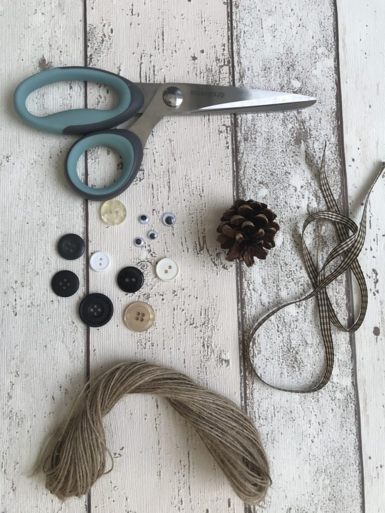 what you need to make pine cone mouse - scissors, buttons, pine cone, ribbon and string