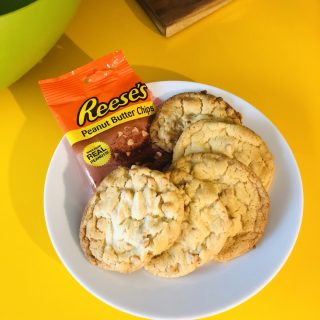 homemade reese's peanut butter chips cookies on top of yellow SMEG fridge