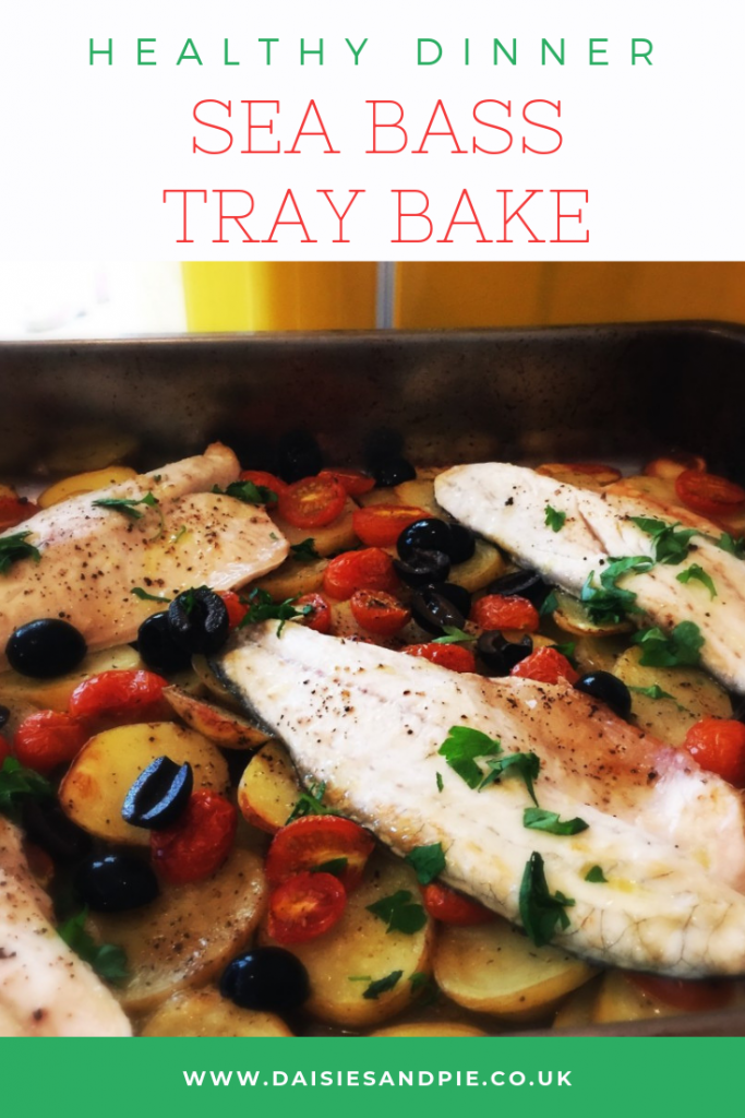 """homemade sea bass tray bake with potatoes, baby plum tomatoes, black olives, sea bass fillets and lots of freshly chopped flat leaf parsley. Text """"healthy dinner - sea bass tray bake"""""""