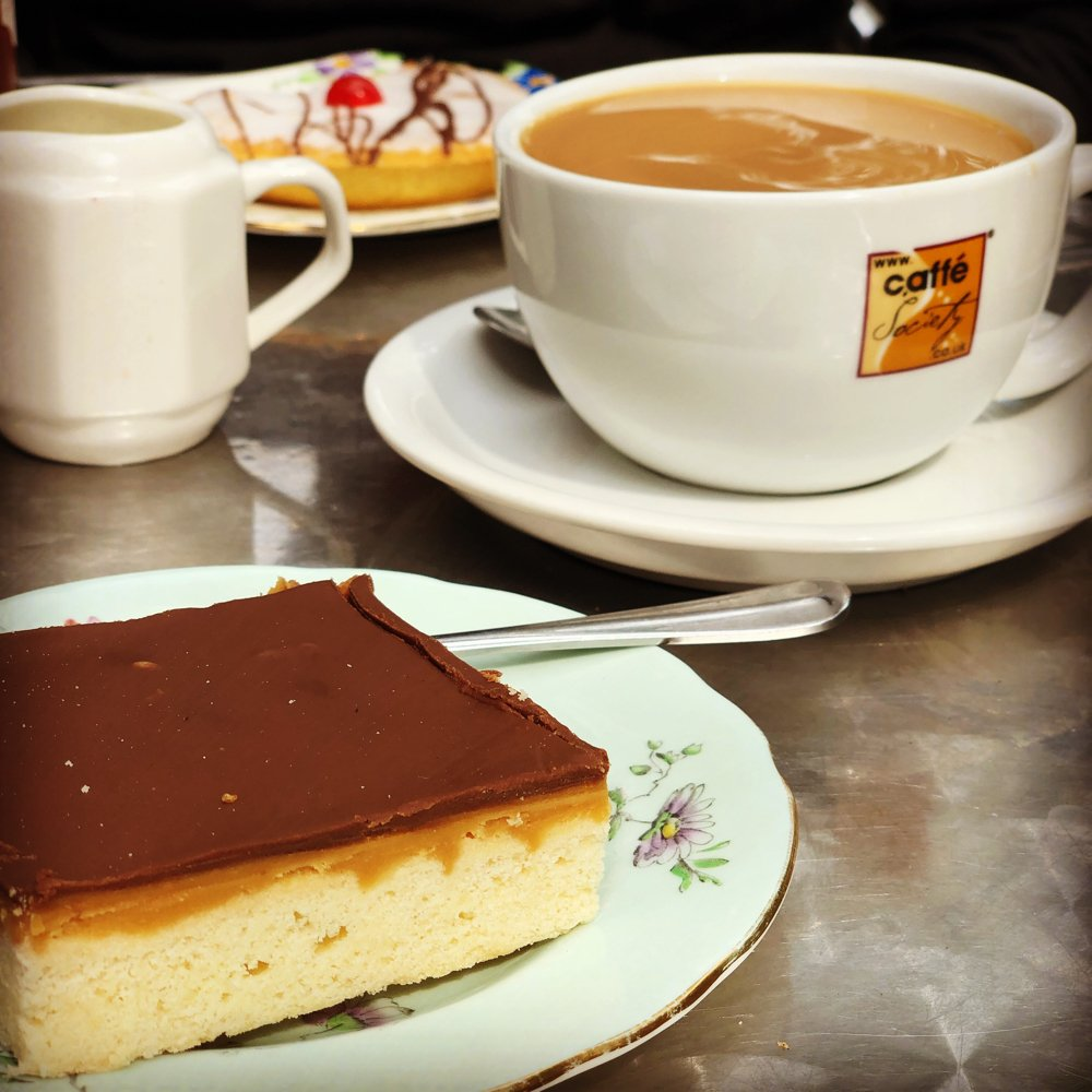 millionaires shortbread from the allotment wigan with coffee and bakewell tart in the background