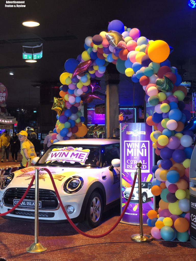 win a mini at coral island blackpool - mini car surrounded by balloons and win me signs
