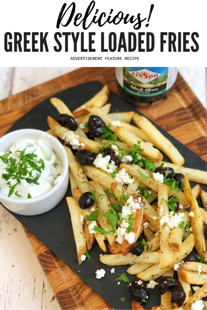 """platter of greek style fries loaded with Crespo black olives and crumbled feta cheese, then scattered with fresh herbs. Text overlay reads """"delicious greek style loaded fries"""""""