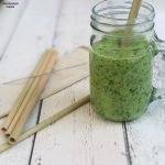 reusable bamboo straws in canvas packet with little cleaning brush. One bamboo straw in kilner jar with green vegan smoothie.