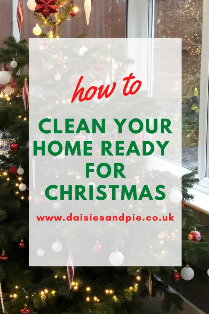 """Christmas tree decorated in red and gold decorations. Text overlay """"how to clean your home ready for Christmas"""""""
