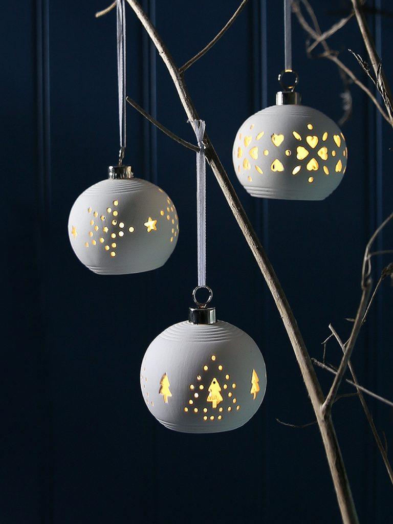 white ceramic illuminated Christmas tree baubles