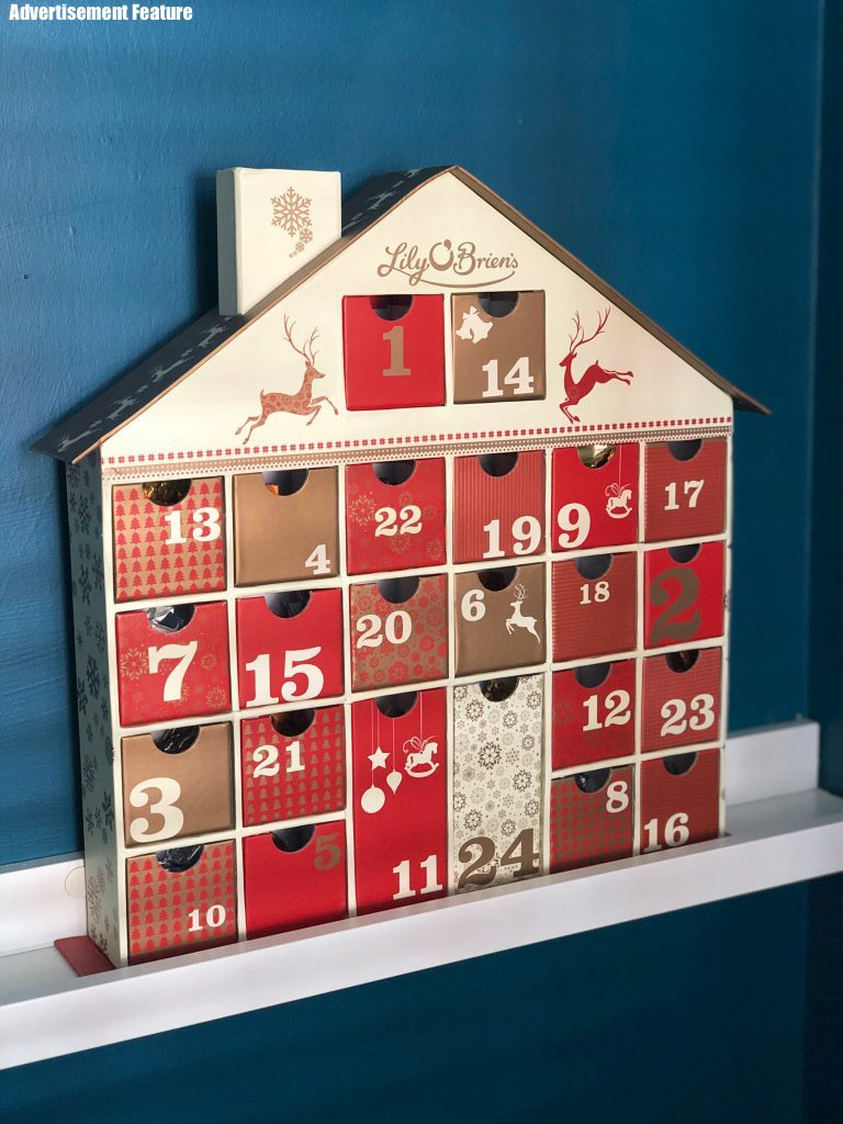 Lily O'Brien's chocolate advent calendar - keepsake advent calendar in shape of house with little drawers you can pull out that are filled with chocolates