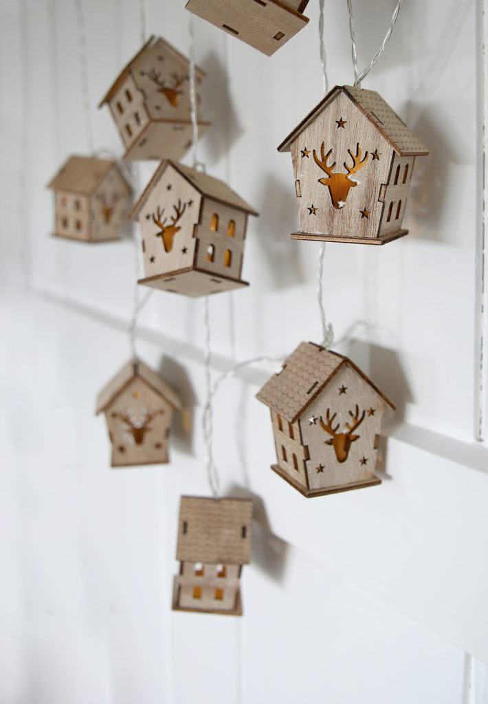 reindeer house string lights - little wooden houses with reindeer head cut out with lights inside