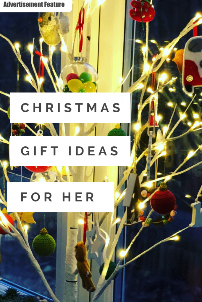 "modern Scandi style Christmas tree with white lights. Text ""Christmas gift ideas for her"""
