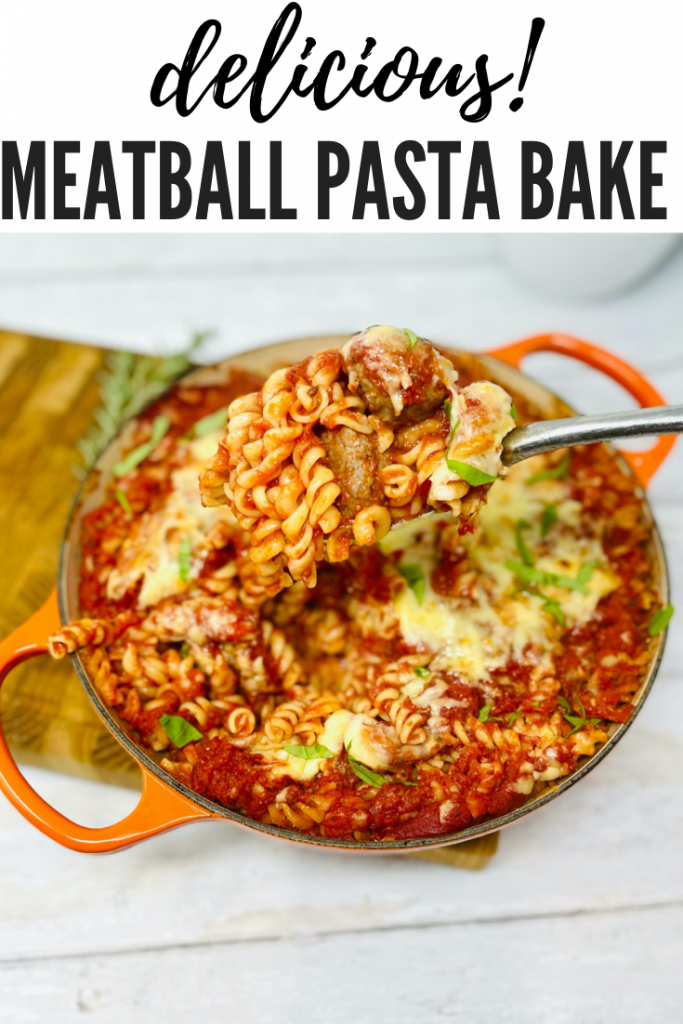 """meatball pasta bake being spooned from the serving dish. Text overlay reads """"delicious meatball pasta bake"""""""