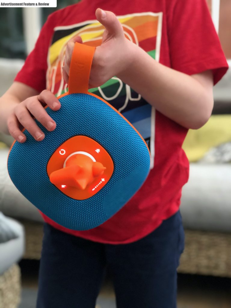 boy carrying the jooki smart speaker