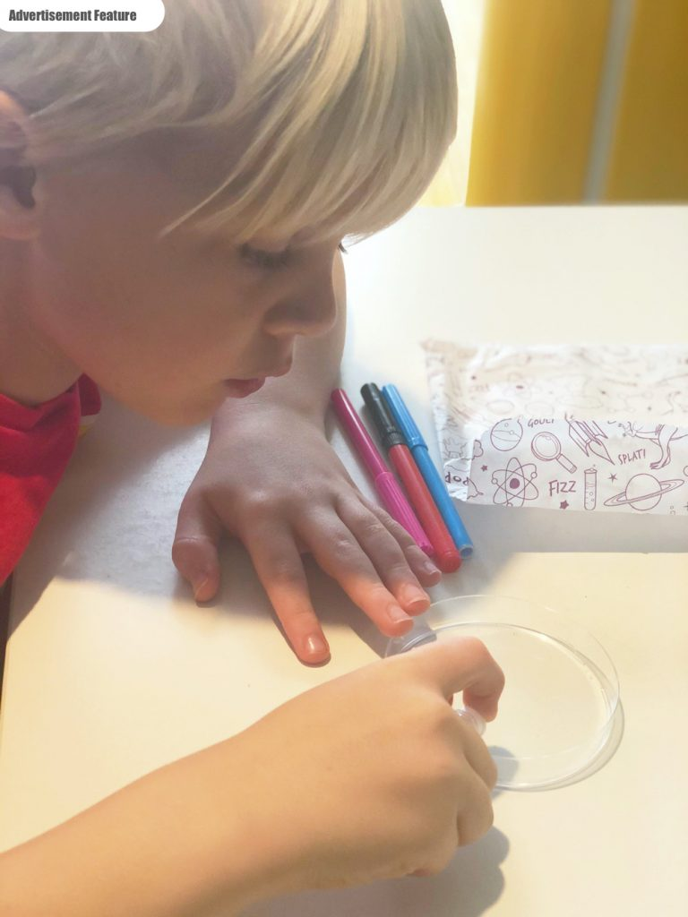 boy doing science experiments from the Letterbox lab science subscription box