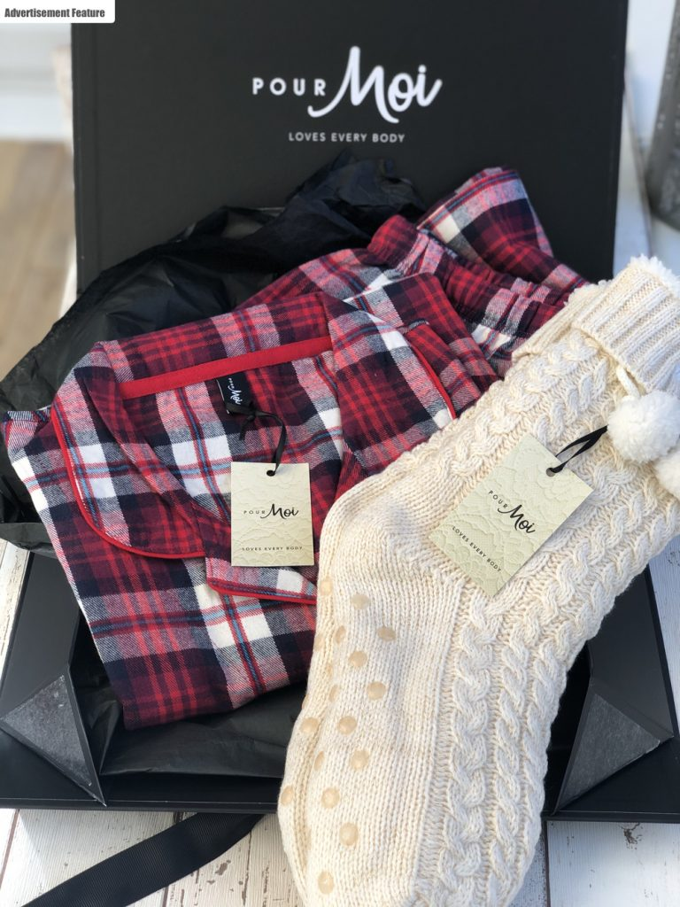pour moi gift box filled with cosy tartan red pyjamas and cream knitted socks with pompoms