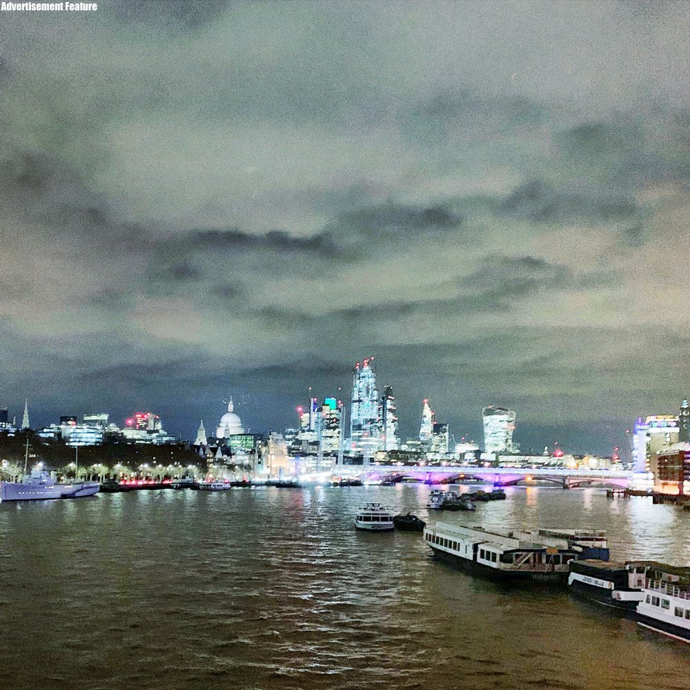 Westminster embankment lit up at night - London skyline