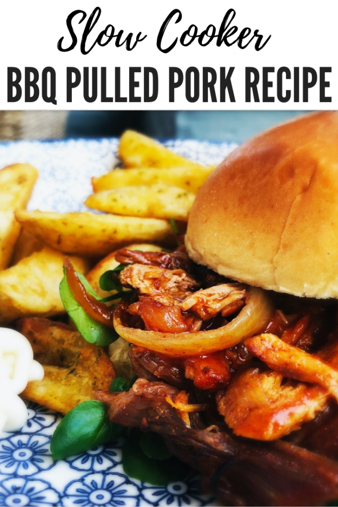 """slow cooker pulled pork in BBQ sauce shredded and stuffed into a brioche bun alongside side dishes of potato wedges and soured cream dip. Text overlay reads """"slow cooker BBQ pulled pork recipe"""""""