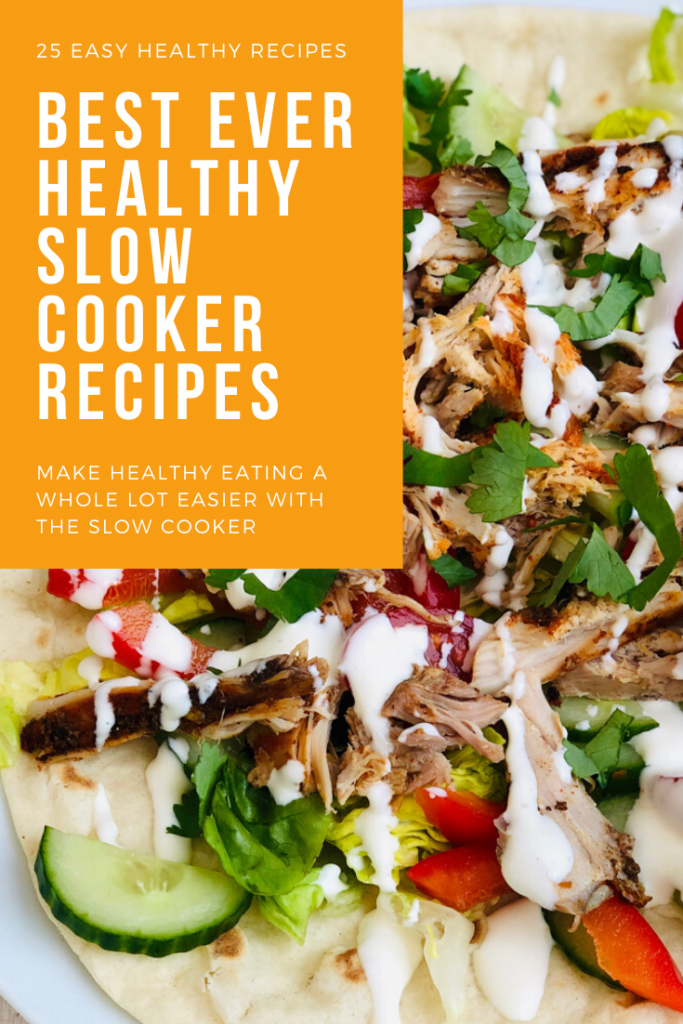 "platter of slow cooker shawarma chicken shredded and served with herbs, salad and chillies with a drizzle of yogurt dressing all on a fluffy flatbread. Text ""25 easy healthy recipes - best ever healthy slow cooker recipes - make healthy eating a whole lot easier with the slow cooker"""